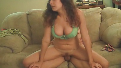 Chick sits on the bfs cock on the couch reverse cowgirl