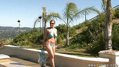 Busty Devon sneaks into an exclusive resort pool