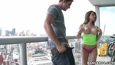 Big tits Rachel Roxxx goes down on public balcony