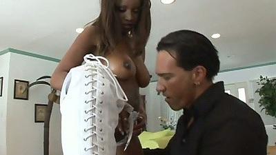 Ebony babe Marco Banderas wearing high boots titty fucks and sucks cock