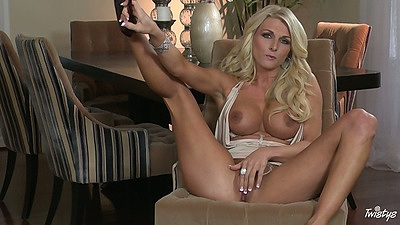 Blonde busty babe Alicia Secrets plays with her shaved pussy