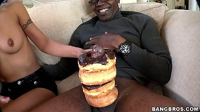 Teen slut Lou Charmelle licks the doughnut cream of cock