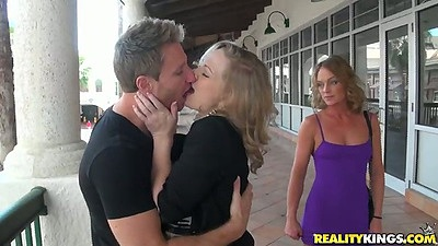 Milf making out outdoors and flashing her boobs by the mall