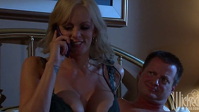 Stormy Daniels talking on the phone then spreads trimmed pussy for licking