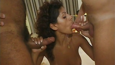 Latina Carol sucking some two nice cocks with doggy style