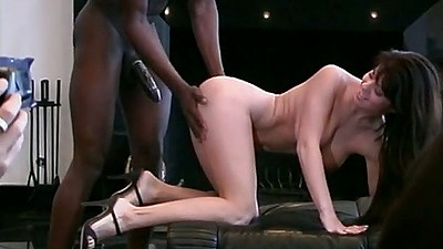 Doggy style interracial rear entry penetration with Sheila Rossi