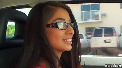 Nice latina Megan Salinas in glasses driving around the streets