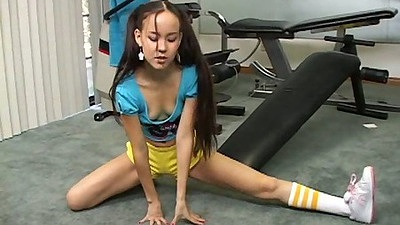 Petite teen girl in tight shorts handjob at the gym during workout