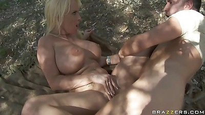 Big tits Holly Halston gets a nice mouthful after park sex