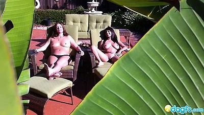 Outdoor voyeur shots of two lesbians sunbathing topless