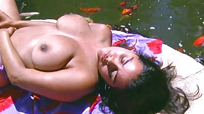Teen with medium sized breasts Alyiah outdoors on the lawn