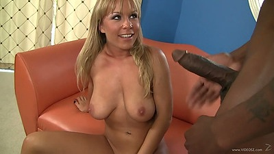 Smiling white girl Jessica Moore sucking on a large super sized black cock