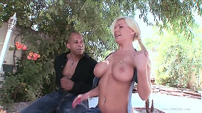 Outdoor blonde Megan Monroe flashing her perfect sized and shaped tits