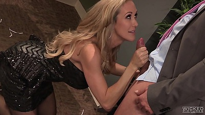 Fully clothed blonde girl Brandi Love sucks off dick at the party
